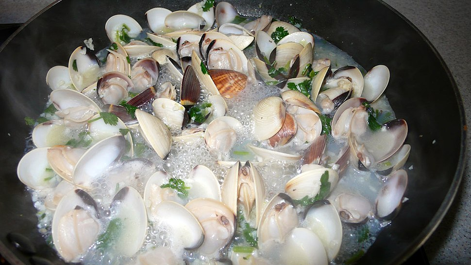 Clams simmering in white wine sauce