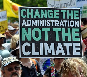 "Individual and political action on climate change - Placard ""Change the administration, not the climate"", at the People's Climate March (2017)."