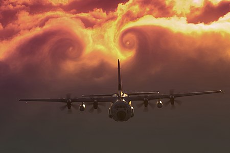 Clouds swirl after a C-130J