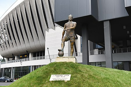 "A statue of ""U"" Cluj's 1940s and 1950s captain Mircea Luca is in front of the Cluj Arena stadium. Cluj-Napoca Cluj Arena 7.jpg"