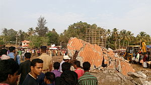 Puttingal temple fire - A collapsed concrete building in Paravur Puttingal Devi Temple premises after the fireworks mishap
