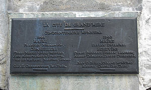 "Grand-Mère, Quebec - A plaque commemorating the 50th anniversary of Grand-Mère attached to the ""old woman"" rock"