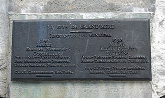 """Grand-Mère, Quebec - A plaque commemorating the 50th anniversary of Grand-Mère attached to the """"old woman"""" rock"""