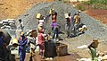 Construction site workers loading water, sand, ballast and cememt into a concrete mixer in Embu, Kenya 6.jpg