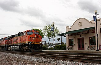 Corcoran station - A BNSF intermodal train passes the station at Corcoran