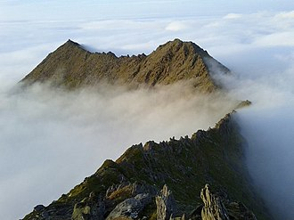 Cruach Mhór - Ridge from Cnoc na Peiste, to The Big Gun (r), and on to Cruach Mhor (l), whose grotto is visible at its summit.