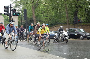Cycling infrastructure - Cyclists use a segregated cut through of a busy interchange in London at rush hour.