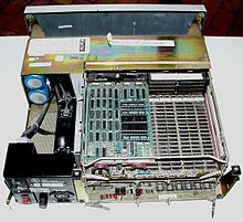 PDP-11/03, cover removed to show the CPU board, with memory board beneath.  Two of the CPU chipset's four 40-pin packages have been removed, and the  optional ...