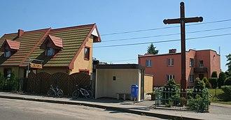 Darżlubie - Bus stop Darżlubie. Barber shop (left)