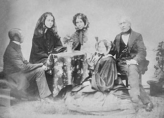 David Brewster - Calvert Jones, Lady Brewster (Jane Kirk Purnell), Mrs. Jones, David Brewster and Miss Parnell (seated)