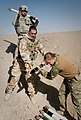 Defense.gov News Photo 101222-A-5634G-003 - A U.S. Army soldier top and British service members place unserviceable rockets into a pit before destroying them outside of Kandahar Airfield.jpg