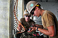 Defense.gov News Photo 110617-O-ZZ999-006 - U.S. Navy Seaman Rodney Peters right and Petty Officer 3rd Class Jared Campos wire an outlet during an engineering civil action project as a part.jpg