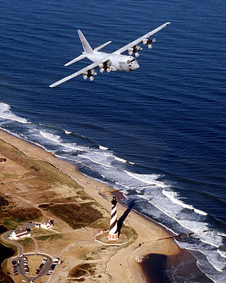 43d Airlift Wing - A 43d Operations Group C-130 flies over the Cape Hatteras lighthouse along the North Carolina coast
