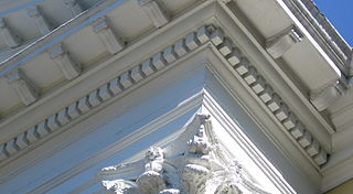Dentil A small block used as a repeating ornament in the bedmould of a cornice