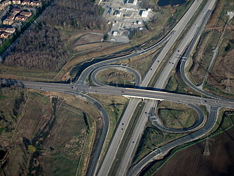 Ontario Highway 407 - Highway 407 and Derry Road, facing southwest; this sections of Highway 407 parallels the boundary between Mississauga (at left) and Milton (at right).