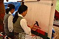 Description- Tibetan carpet weavers from Nepal demonstrate their skills during the 2002 Smithsonian Folklife Festival featuring The Silk Road. (2548100217).jpg