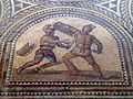 Detail of Gladiator mosaic, a Thraex (left) fighting a Murmillo (right), Römerhalle, Bad Kreuznach, Germany (8196070427).jpg