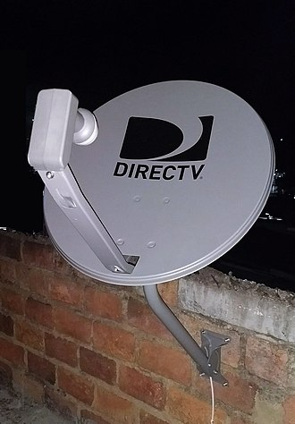 DirecTV - A standard DirecTV satellite dish with Dual LNB on a brick wall