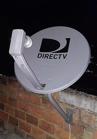 DirecTV - A standard DirecTV satellite dish with Dual LNB on a brick wall
