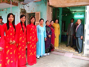 Culture of Vietnam - The family of a Vietnamese bride line up to welcome her groom at their betrothal ceremony.