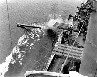 Mahan-class destroyer - Dunlap firing a torpedo from starboard waist torpedo tubes, July 1942