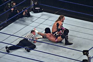 Sharpshooter (professional wrestling) - Edge, applying the variation of a kneeling sharpshooter on CM Punk.
