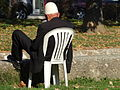 Elderly man catches the rays along Pena River in Tetovo, Macedonia.jpg