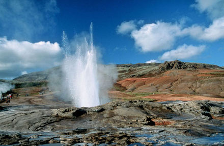 The erupting Geysir in Haukadalur valley, the oldest known geyser in the world - Iceland