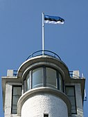 Flag of Estonia on top of Suur Munamagi watch tower, the highest point in Estonia and Baltic states, at 318m above sea level
