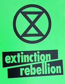 Extinction Rebellion, green placard (cropped).jpg