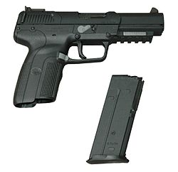 Photo of the Five-seven USG pistol with an empty 20-round magazine