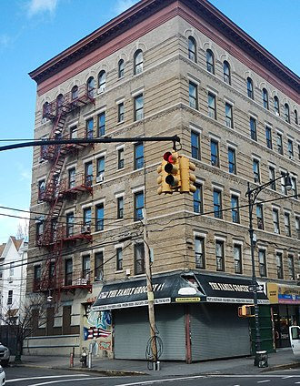 Melrose, Bronx - Looking northwest at apartment building on Melrose Avenue and E 154th Street