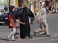Family in Street - Shush - Southwestern Iran (7423708642).jpg
