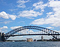 Ferry passing under the Sydney Harbour Bridge (15967486387).jpg