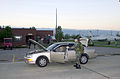 First Lieutenant (1LT) Thad E Shepard, USAF, (standing left behind car), 188th Fighter Wing, Arkansas Air National Guard, Fort Smith, submits to a random vehicle search performed by the 188th Security Forces 010919-F-EF792-002.jpg