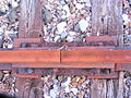 Fishplate bolted horizontally through web of rail and nailed vertically, too160.jpg