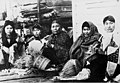 Five Tlingit women weaving spruce root baskets, circa 1903 (AL+CA 806).jpg