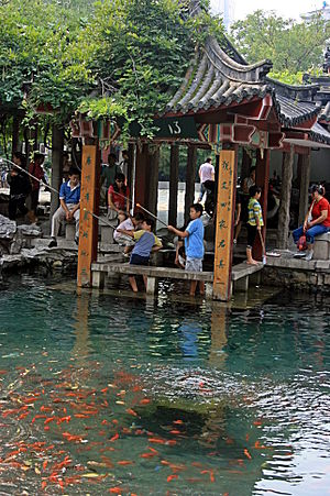 Five Dragon Pool - Pavilion at the edge of a spring pool in the Five Dragon Pool Park