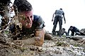 Flickr - Official U.S. Navy Imagery - A first-year midshipman, or plebe, is splashed with mud..jpg