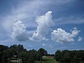 Fluffy Clouds over Cannan River New Brunswick (8297209767).jpg