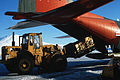 Forklift loads supplys on LC-130R at McMurdo Station c1987.JPEG
