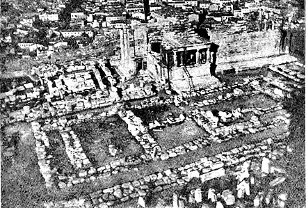 Foundations of the Old Temple of Athena, destroyed by the armies of Xerxes I during the Destruction of Athens in 480 BC. Foundations of the Old Athena Temple (foreground).jpg
