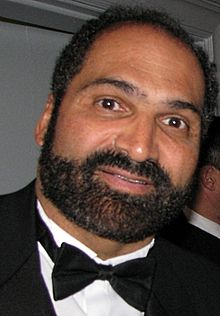 Posed head-and-shoulders photograph of Harris wearing a black tuxedo and black tie