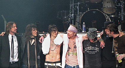 "Guns N' Roses in 2010. From left to right: Dizzy Reed, Ron ""Bumblefoot"" Thal, Richard Fortus, Axl Rose, DJ Ashba, Chris Pitman, and Tommy Stinson. Drummer Frank Ferrer is not pictured. GNR 2010.jpg"