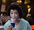 Geiko Miharu drinking beer (14351109112).jpg