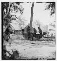 Gen. Ambrose E. Burnside (reading newspaper) with Mathew B. Brady (nearest tree) at Army of the Potomac headquarters LOC cwpb.01702.tif