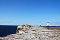 Girl on a cliff top (3875600266).jpg