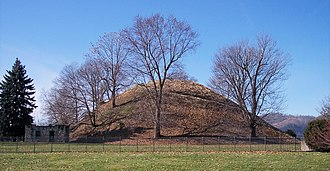 History of the United States - Grave Creek Mound, located in Moundsville, West Virginia, is one of the largest conical mounds in the United States. It was built by the Adena culture.