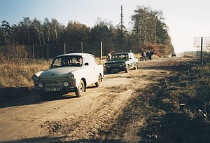 Fall of the inner German border - East German cars entering West Germany through a newly cut hole in the border fence