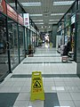 HK Sheung Wan 中源廣場 Midland Plaza 中源中心 Midland Centre 37 shopping mall interior Wet Floor sign Perspective view Aug-2010.JPG
